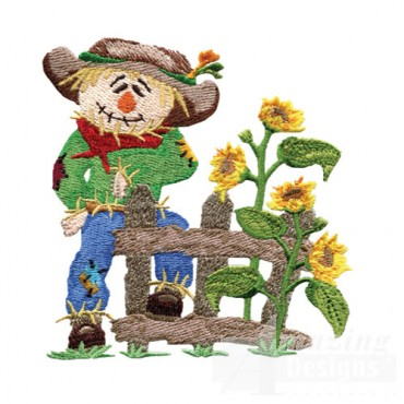 Scarecrow By Fence